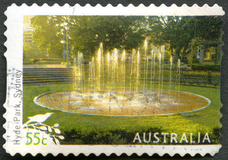 borne fontaine: AUSTRALIA - CIRCA 2009: A used postage stamp from Australia, depicting an image of Hyde Park in Sydney, circa 2009.