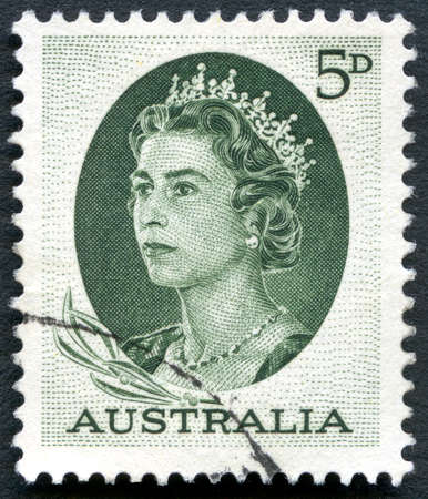 philately: AUSTRALIA - CIRCA 1963: A used postage stamp from Australia, depicting a portrait of Queen Elizabeth II, circa 1963. Editorial