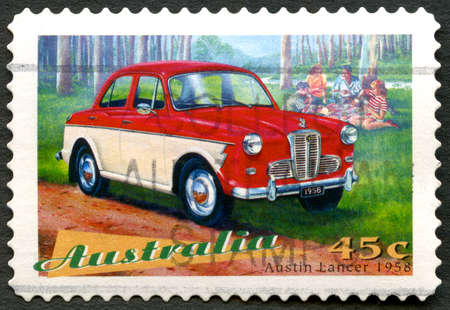 AUSTRALIA - CIRCA 1997: A used postage stamp from Australia, depicting an illustration of an Austin Lancer 1958 automobile, circa 1997.