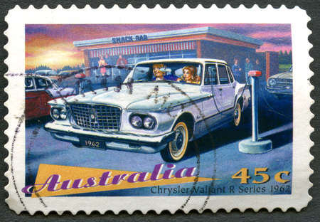 AUSTRALIA - CIRCA 1997: A used postage stamp from Australia, depicting an illustration of a Chrysler Valiant R Series 1962 automobile, circa 1997.