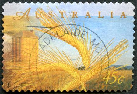 AUSTRALIA - CIRCA 1998: A used postage stamp from Australia, depicting an illustration of wheat farming, circa 1998.