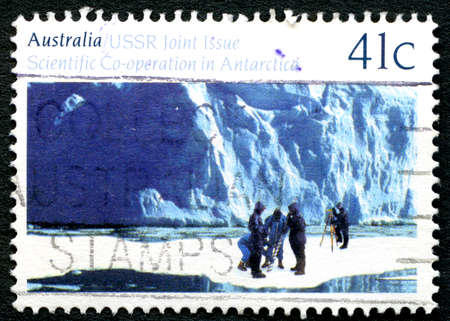 co operation: AUSTRALIA - CIRCA 1990: A used postage stamp from Australia, commemorating Australia and USSRs scientific co-operation in Antarctica, circa 1990. Editorial