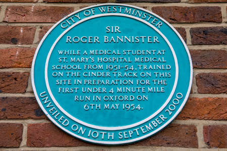 A plaque located in Paddington Recreation Ground in London, marking the area where Sir Roger Bannister trained in preparation for the first under 4 minute mile run. Editorial