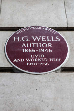 novelist: LONDON, UK - FEBRUARY 16TH 2017: A plaque on Baker Street in London, marking the location where famous author HG Wells lived and worked, taken on 16th February 2017.