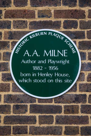 LONDON, UK - FEBRUARY 16TH 2017: A plaque marking the location where author and playwright A.A Milne was born in Kilburn, West London, taken on 16th February 2017.