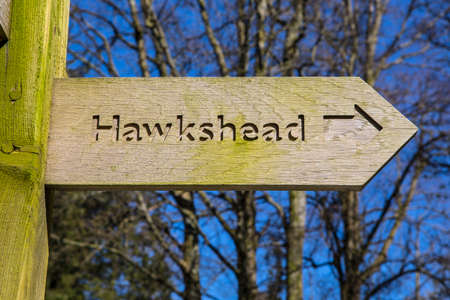 northwest: A sign pointing towards the direction of Hawkshead in the Lake District in Cumbria, UK.