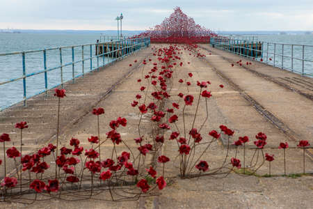 SOUTHEND-ON-SEA, UK - APRIL 16TH 2017:  The Poppy Wave installation by Paul Cummins and Tom Piper on Barge Pier in Shoeburyness, Southend-On-Sea, on 16th April 2017.