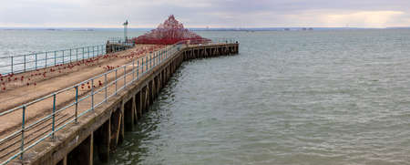 centenary: SOUTHEND-ON-SEA, UK - APRIL 16TH 2017:  The Poppy Wave installation by Paul Cummins and Tom Piper on Barge Pier in Shoeburyness, Southend-On-Sea, on 16th April 2017.
