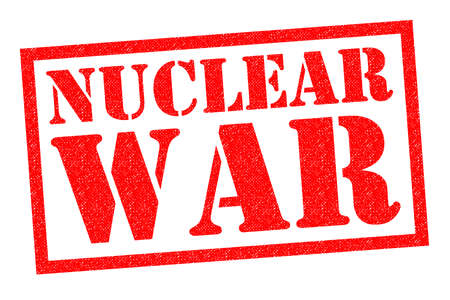 warned: NUCLEAR WAR red Rubber Stamp over a white background.