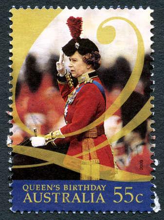 AUSTRALIA - CIRCA 2009: A used postage stamp from Australia, depicting a portrait of Queen Elizabeth II to celebrate her birthday, circa 2009. Editöryel