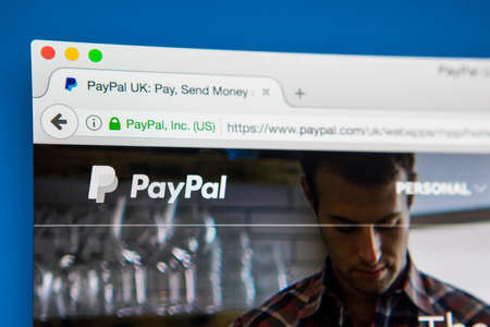 transfers: LONDON, UK - APRIL 28TH 2017: The homepage of the official website for Paypal, the online money payment system, on 28th April 2017.
