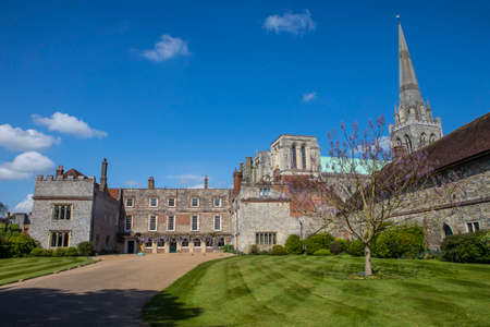 A view of Bishops Palace and the spire of Chichester Cathedral in the beautiful cathedral city of Chichester in Sussex, UK.
