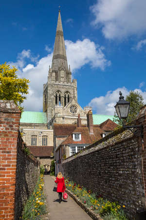CHICHESTER, UK - APRIL 29TH 2017: A view of the spire of Chichester Cathedral and St. Richards Walk in the historic city of Chichester in Sussex, UK, on 29th April 2017.