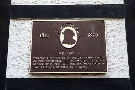 novelist: ROCHESTER, UK - APRIL 22ND 2017: A plaque at Mr Topes in Rochester detailing the historic connection with the stories by famous author Charles Dickens, on 22nd April 2017.