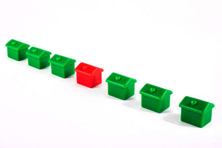 A row of toy houses over a plain white background.