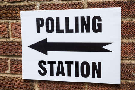 voted: A sign pointing in the direction of a Polling Station on election day in the United Kingdom. Stock Photo