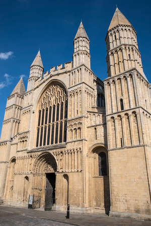 church steeple: A view of the main entrance into the historic Rochester Cathedral in Kent, UK.