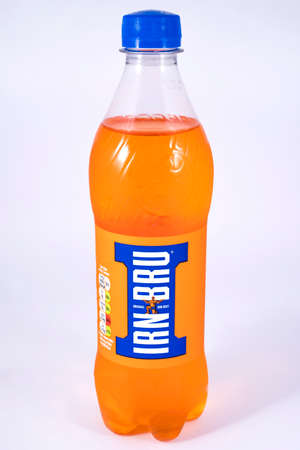 LONDON, UK - JULY 7TH 2017: An unopened bottle of Irn-Bru over a plain white background, on 7th July 2017.