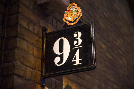 k 9: LEAVESDEN, UK - JUNE 19TH 2017: The sign for Platform 9 34 at the Making of Harry Potter Studio tour at the Warner Bros. Studios in Leavesden, UK, on 19th June 2017.