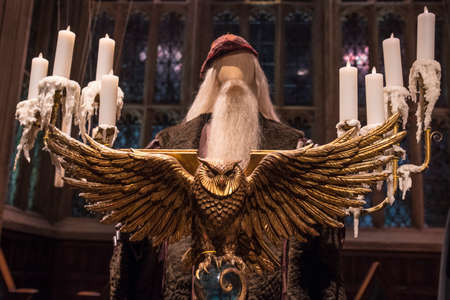 LEAVESDEN, UK - JUNE 19TH 2017: The golden Owl Lecturn on the set of the Great Hall at Hogwarts, at the Making of Harry Potter studio tour at the Warner Bros studios in Leavesden, UK, on 19th June 2017.