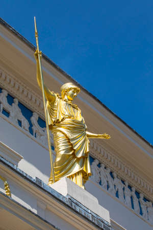 private club: A golden statue of Athena, the classical goddess of wisdom, outside the famous Athenaeum Club in central London, UK.