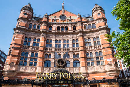 LONDON, UK - JUNE 14TH 2017: A view of the front entrance to the Palace Theatre promoting its play Harry Potter and the Cursed Child, in London, on 14th June 2017.