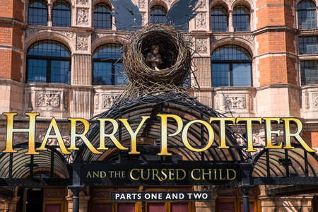 shaftesbury: LONDON, UK - JUNE 14TH 2017: A view of the front entrance to the Palace Theatre promoting its play Harry Potter and the Cursed Child, in London, on 14th June 2017.