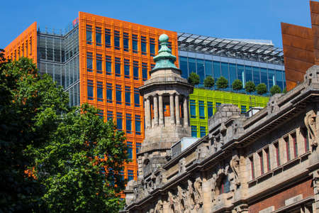 giles: The tower of the famous Shaftesbury Theatre with the bright coloured facade of Central Saint Giles in the background in central London.