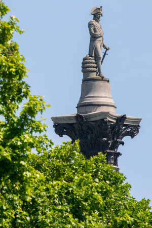 trafalgar: The statue of Vice Admiral Horatio Nelson on top of Nelsons Column, viewed from The Mall in London, UK. Editorial