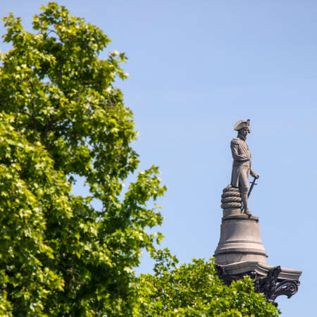 The statue of Vice Admiral Horatio Nelson on top of Nelsons Column, viewed from The Mall in London, UK. Stock Photo