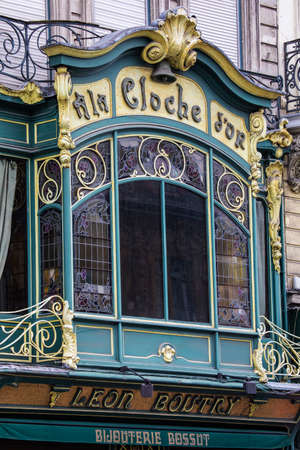 artdeco: LILLE, FRANCE - JUNE 25TH 2017: The beautiful art-deco exterior of A La Cloche D'or, a jewellery shop situated on Place du Theatre in Lille, France, on 25th June 2017. Editorial
