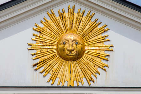 A close-up of a sun sculpture on the exterior of one of the buildings on Grand Place in the historic city of Lille in France.  Possiblly in homage to Louis XIV of France who was known as the Sun King. Stock Photo