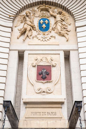 cherubs: Close-up of the Lille Coat of Arms on the Porte de Paris in the historic city of Lille in France.