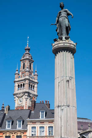 View in Grand Place in the historical city of Lille, France. The view includes the Column of the Goddess, and the belfry of the Chamber of Commerce and Industry.