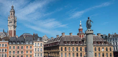 View in Grand Place in the historical city of Lille, France. The view includes the Column of the Goddess, Vieille Bourse, and the Chamber of Commerce and Industry.