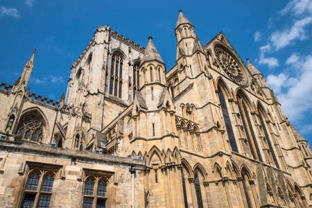 A view of the south-facing facade of York Minster in the historic city of York, England.
