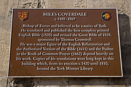 A plaque on York Minster in the historic city of York, dedicated to Miles Coverdale, who translated and published the first complete English Bible in 1535. Banco de Imagens