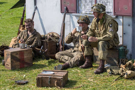 KENT, UK - AUGUST 28TH 2017: Actors posing as American soldiers from the 2nd World War, at the Military Odyssey Re-enactment event in Detling, Kent, on 28th August 2017.