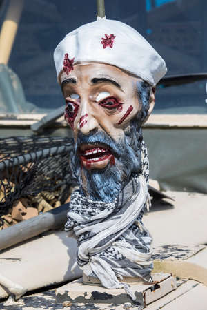 KENT, UK - AUGUST 28TH 2017: A mask showing the wounded face of Osama Bin Laden on an American military vehicle at the Military Odyssey reenactment event at Detling, in Kent, on 28th August 2017.