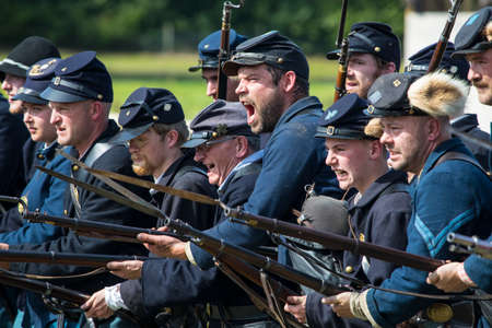 musket: KENT, UK - AUGUST 28TH 2017: Actors posing as Union soldiers from the American Civil War, at the Military Odyssey Re-enactment event in Detling, Kent, on 28th August 2017.