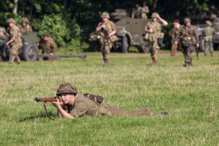 're: KENT, UK - AUGUST 28TH 2017: Actor posing as a British soldier from the 2nd World War, at the Military Odyssey Re-enactment event in Detling, Kent, on 28th August 2017.