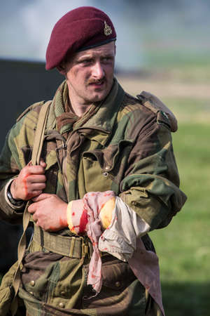're: KENT, UK - AUGUST 28TH 2017: Actor posing as a wounded British soldier from the 2nd World War, at the Military Odyssey Re-enactment event in Detling, Kent, on 28th August 2017.