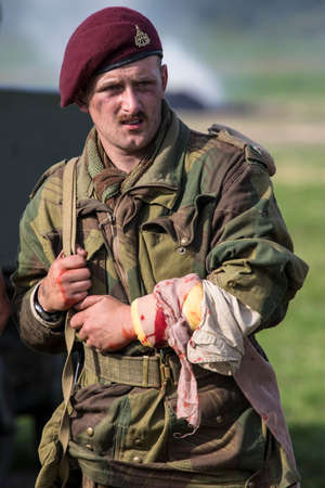 KENT, UK - AUGUST 28TH 2017: Actor posing as a wounded British soldier from the 2nd World War, at the Military Odyssey Re-enactment event in Detling, Kent, on 28th August 2017.