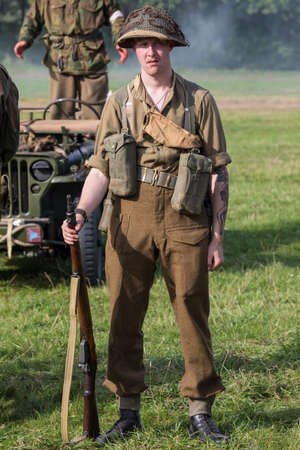 KENT, UK - AUGUST 28TH 2017: Actor posing as a British soldier from the 2nd World War, at the Military Odyssey Re-enactment event in Detling, Kent, on 28th August 2017.