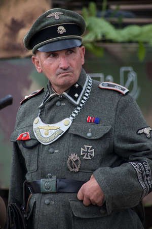 KENT, UK - AUGUST 25TH 2012: Actor posing as German Military Police from the 2nd World War, at the Military Odyssey Re-enactment event in Detling, Kent, on 25th August 2012.
