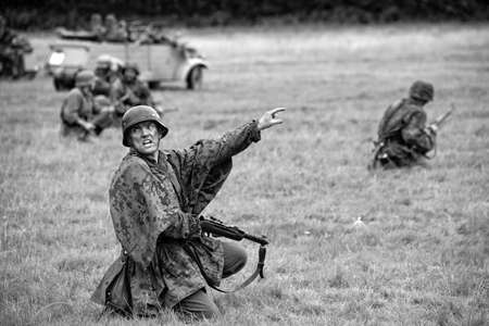 KENT, UK - AUGUST 25TH 2012: Actors posing as German soldiers from the 2nd World War, at the Military Odyssey Re-enactment event in Detling, Kent, on 25th August 2012.