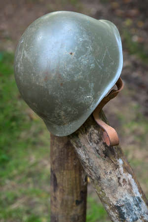 A discarded American World War Two helmet.