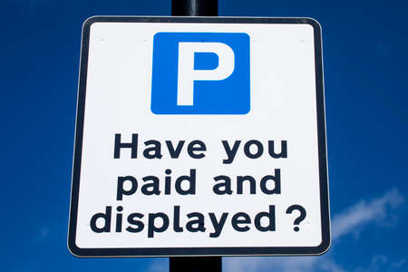 A sign asking drivers if they have paid and displayed in a Pay and Display Car Park.