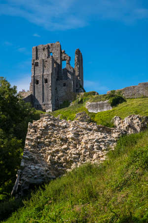 DORSET, UK - AUGUST 16TH 2017: A view of the ruins of Corfe Castle in the beautiful county of Dorset in the UK, on 16th August 2017.