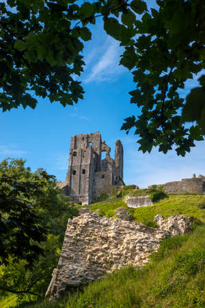 old english: DORSET, UK - AUGUST 16TH 2017: A view of the ruins of Corfe Castle in the beautiful county of Dorset in the UK, on 16th August 2017.